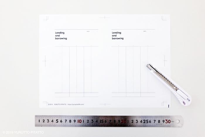 印刷したメモとカッターと定規